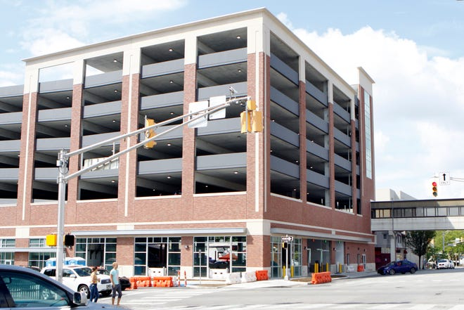 People come and go from the new Fourth Street garage in downtown Bloomington  during the Fourth Street Festival of the Arts and Crafts on Labor Day weekend. The structure opened for parking in August, but some finishing touches are still in progress.