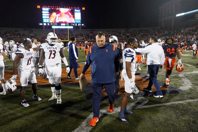 Illinois head coach Bret Bielema, center, walks off the field after his team's loss to UTSA in an NCAA college football game Saturday, Sept. 4, 2021, in Champaign.