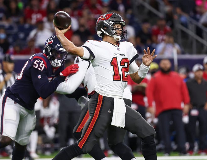 Aug 28, 2021; Houston, Texas, USA; Tampa Bay Buccaneers quarterback Tom Brady (12) attempts a pass during the first quarter against the Houston Texans at NRG Stadium. Mandatory Credit: Troy Taormina-USA TODAY Sports