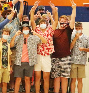 Pontiac Township High School students don masks while cheering on their schoolmates at a recent volleyball match. The IHSA has mandated that all fans, administrators and participants of indoor sports must wear masks.