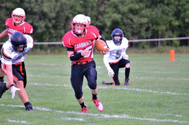 Senior halfback Logan May carries the ball against Elk Rapids. May led the team with 142 yards and two touchdowns.