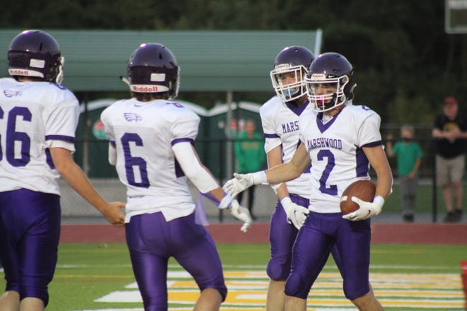 Marshwood's Cam Cornett (2) celebrates with teammates after scoring a touchdown in Saturday's 45-2 win over Massabesic.