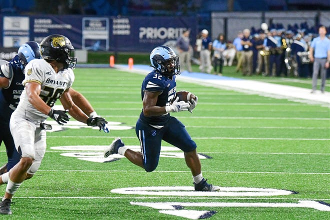URI running back Justice Antrum, who finished with 18 carries for 96 yards and two touchdowns in the Rams' 45-21 victory, finds an opening against Bryant defenders on Saturday night at Meade Stadium in Kingston.