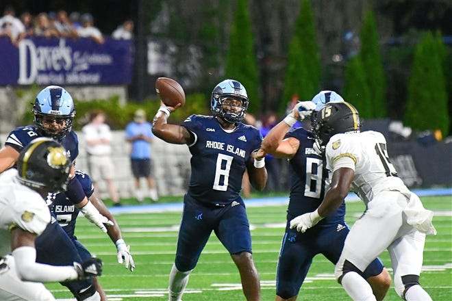 URI's Kasim Hill looks to pass in the Rams' opening game Saturday night against Bryant in Kingston.