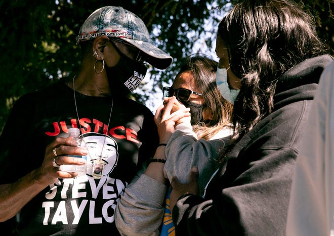 Steven Taylor's grandmother, Addie Kitchen, left, comforts Cassandra Quinto-Collins, center, mother of Angelo Quinto at a celebration of life held for Taylor on the one-year anniversary of his death, on April 18, 2021. Both Taylor and Quinto were killed by police during mental health crises.