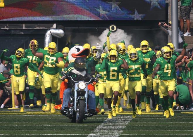 The Oregon football team enters Autzen Stadium for the season opener against Fresno State.