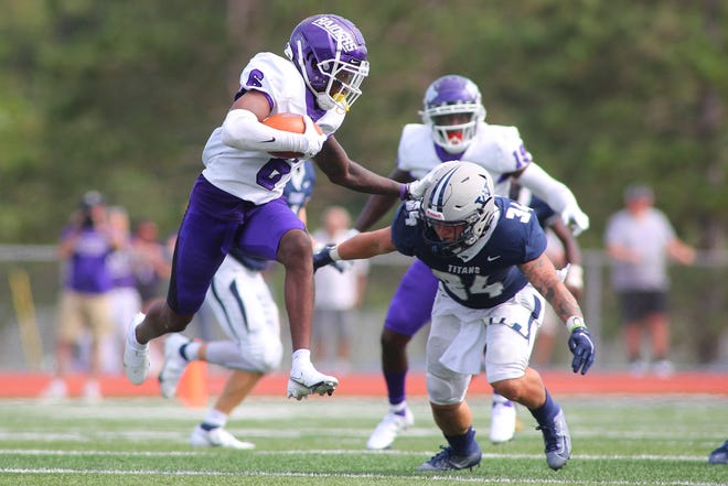 Mount Union's Wayne Ruby Jr. (6) tries to elude a Westminster defender after making a catch during Saturday's game.