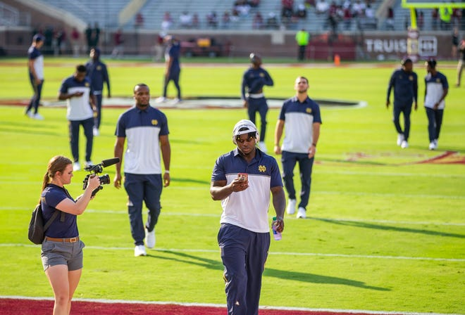 Notre Dame players head to the locker room after arrive on the field before the Notre Dame-Florida State NCAA football game on Sunday, Sept. 5, 2021, in Tallahassee, Florida.