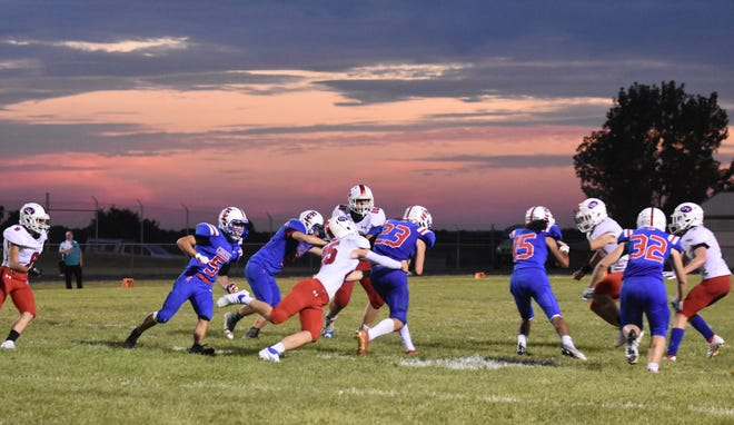 Friday night lights under a beautiful Indiana sky... OV sophomore Cale Nickless takes down Indian Creek's Brandon Murray during Friday night's win against the host Braves. More from the Patriots win is featured inside today's SEW.