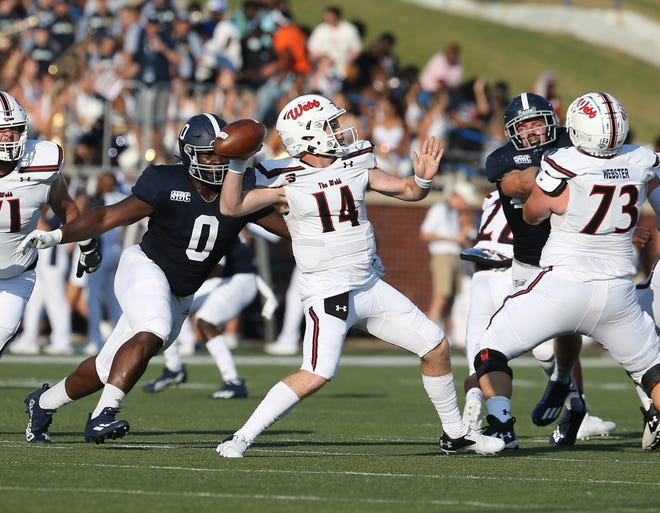 Georgia Southern's C.J. Wright closes in on Gardner-Webb quarterback Bailey Fisher during the season opener.