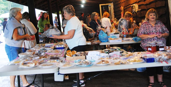 A wide variety of baked goods and baskets for the basket raffle were on hand Sunday morning at the annual St. Gregory's Labor Day Picnic in Macdonaldton. Inside the social hall, family-style turkey and ham dinners were served.