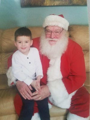 """Santa"" Joseph Thompson and his grandson, Corbin Hathaway"