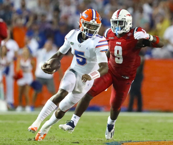 Florida quarterback Emory Jones runs for a big gain Saturday against the Florida Atlantic Owls at Ben Hill Griffin Stadium. Jones was far from sharp, finishing with a touchdown and two interceptions in his first career start.