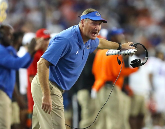 Florida Gators head coach Dan Mullen yells to a referee on the sidelines during a game against the Florida Atlantic Owls at Ben Hill Griffin Stadium in Gainesville Fla. Sept. 4, 2021.