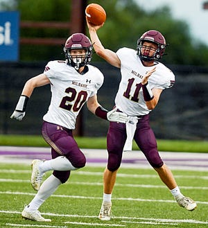 Milbank Area's Kaden Krause (11) throws a pass as teammate Karson Weber looks on their 32-6 loss to fourth-rated Class 11A Sioux Falls Christian on Friday. Krause has been chosen as one of top area performers from this week's high school football games.