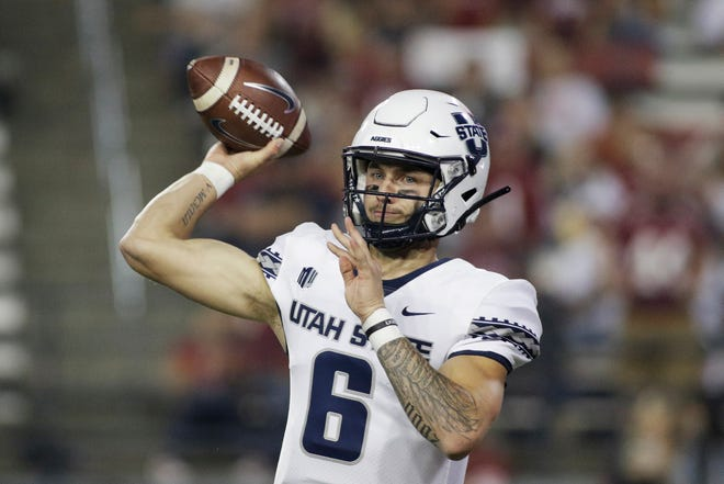 Utah State quarterback Andrew Peasley throws a pass during the first half of the team's NCAA college football game against Washington State, Saturday, Sept. 4, 2021, in Pullman, Wash. (AP Photo/Young Kwak)
