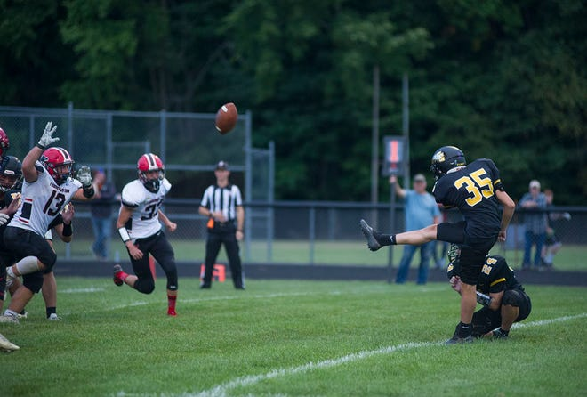 Colonel Crawford's Braxton Morton boots an extra point against Cardington-Lincoln. He was 8-of-8 from the spot and nailed a 25-yard field goal.