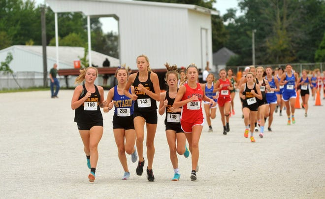 Colonel Crawford's Izzy Roston, Cecelia Chase and Gabby Roston battled with Ontario's Ellie Mauer and Pleasant's Olivia Pratt throughout the race at the Crawford County Fairgrounds in the Bucyrus Elks Invitational.