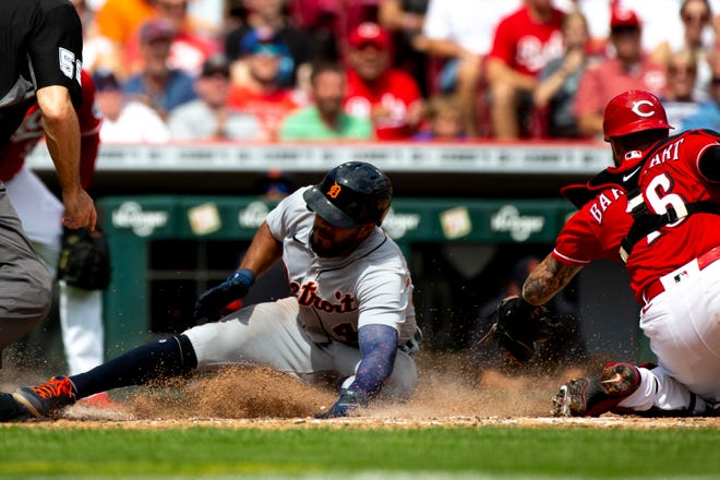 Detroit Tigers third baseman Jeimer Candelario (46) scores after tagging up as Cincinnati Reds catcher Tucker Barnhart (16) attempts to tag him out in the sixth inning of the MLB baseball between the Cincinnati Reds and the Detroit Tigers on Sunday, Sept. 5, 2021, at Great American Ball Park in Cincinnati.