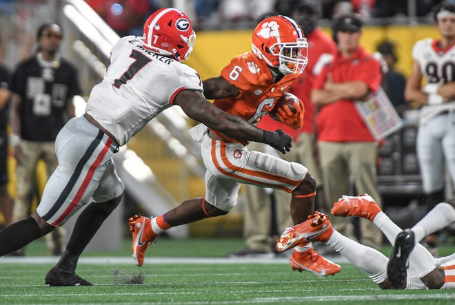 Clemson wide receiver E.J. Williams(6) is tackled by  Georgia linebacker Quay Walker(7) during the second quarter of the Duke's Mayo Classic Sep 4, 2021; Charlotte, North Carolina, USA;  at Bank of America Stadium. (Ken Ruinard-USA TODAY Sports)