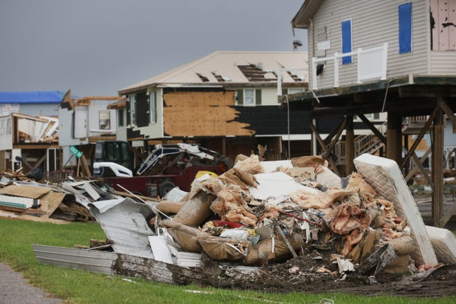 Destruction and flooding along Cocodrie, La. where damage from the path of Hurricane Ida remains on Sunday, Sept. 5, 2021.