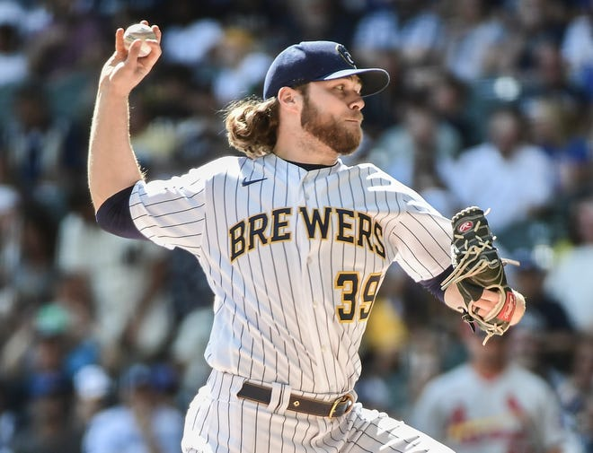 Milwaukee Brewers pitcher Corbin Burnes throws a pitch against the St. Louis Cardinals at American Family Field.