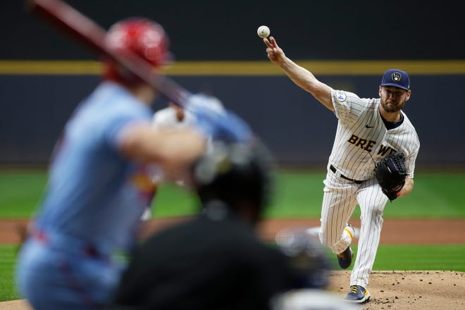 Adrian Houser of the Milwaukee Brewers throws a pitch in the first inning against the St. Louis Cardinals at American Family Field on Sept. 4, 2021.