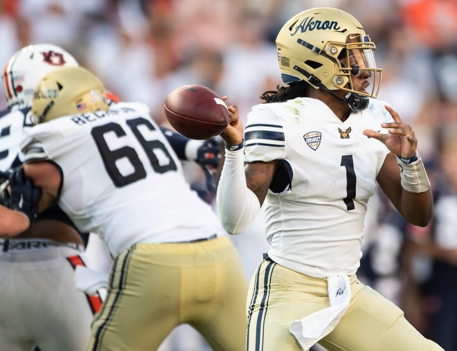 University of Akron quarterback Kato Nelson (1) fumbles the ball during the Zips' loss to Auburn last Saturday. A better gauge of what kind of team UA is, should come after Saturday's game against Temple at InfoCision Stadium. [USA TODAY Network]