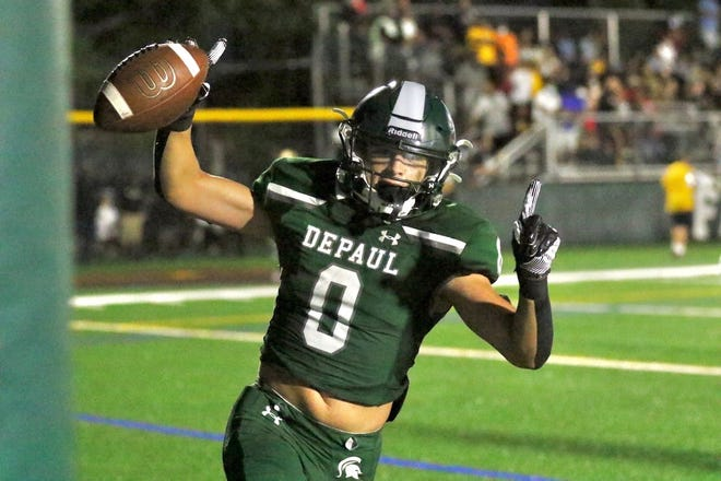 DePaul running back Tyler Brown celebrates a first half touchdown in the Spartans 40-19 win over Cardinal Hayes.