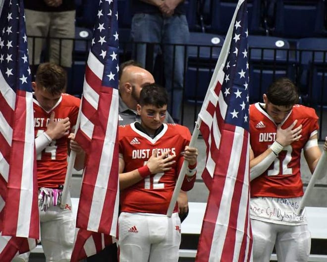 River Valley football players honor the 13 fallen soldiers in Afghanistan before Friday's game against Arizona College Prep. Photo by Erik Johnson