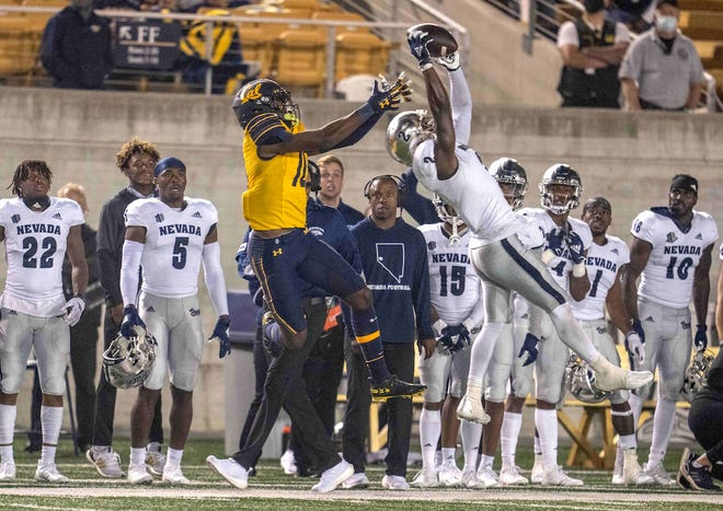 Wolf Pack cornerback Isaiah Essissima (2) intercepts a pass intended for Cal receiver Jeremiah Hunter during the fourth quarter at Memorial Stadium.