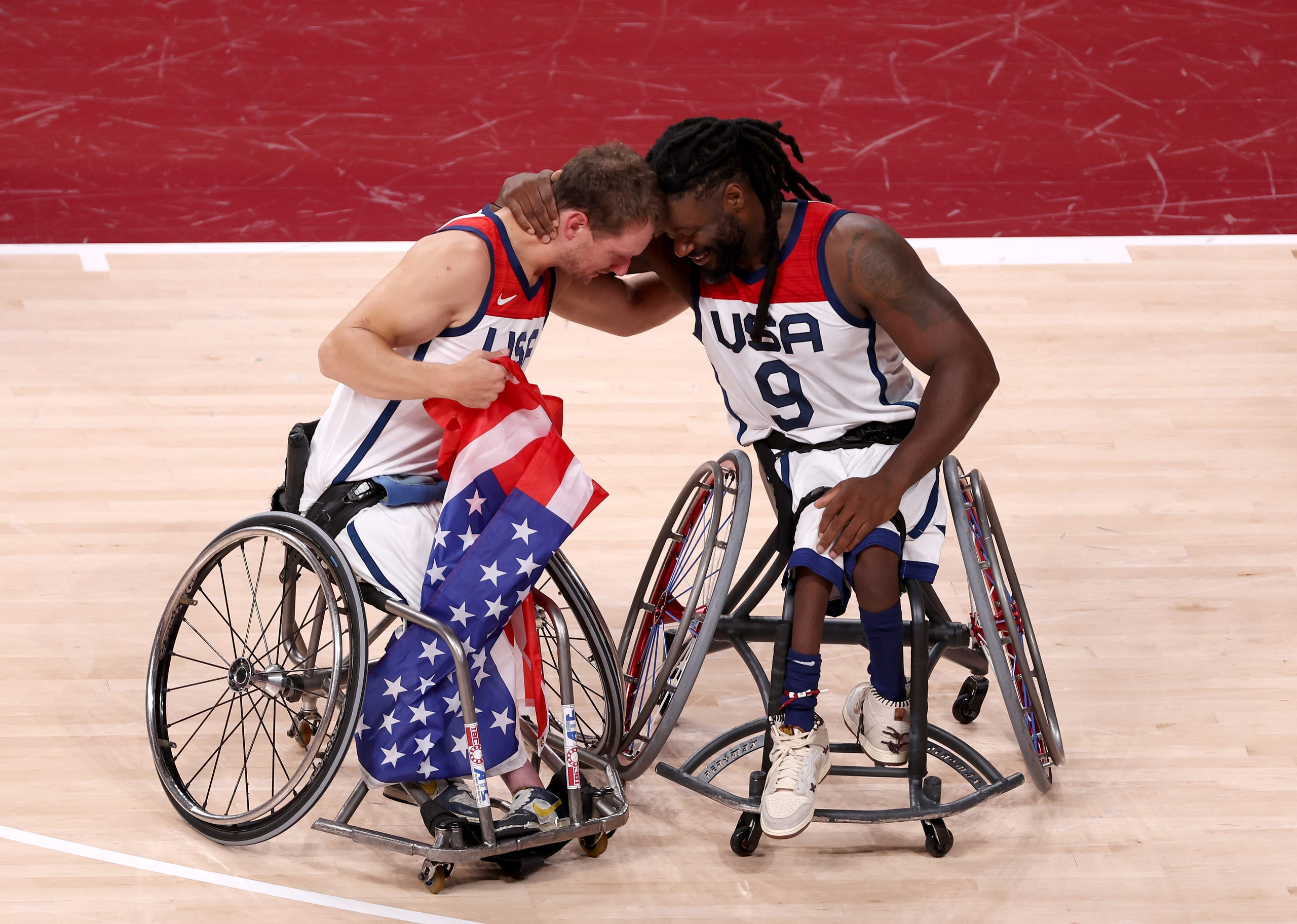 Sept. 5, 2021: Michael Paye #5 and Matt Scott #9 of Team United States celebrate after defeating Team Japan during the men's Wheelchair Basketball gold medal game on day 12 of the Tokyo 2020 Paralympic Games at Ariake Arena in Tokyo, Japan.