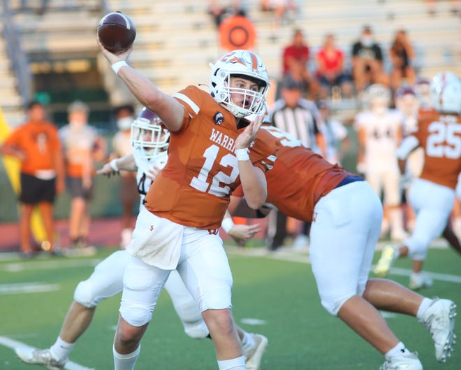 Mike Davis fires the ball to his Westwood receiver against Austin High in nondistrict action Sept. 3 at Dragon Stadium. Davis, a sophomore quarterback, completed 24 of 38 passes for 259 yards and five touchdowns as the Warriors took a 42-27 win over Austin High.