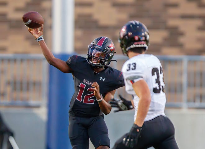 Weiss Wolves quarterback Dior Bradfield throws a pass against the Harker Heights Knights during the season opener. Bradfield leads the Wolves into a nondistrict showdown against Rouse this week.