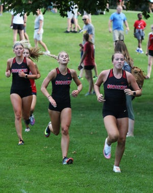 Claire Truesdell, Elizabeth Ihle and Reece Johnson placed ninth, 10th and 11th respectively in helping the Roland-Story girls take fourth at the Lynx Invitational in Webster City Aug. 31.