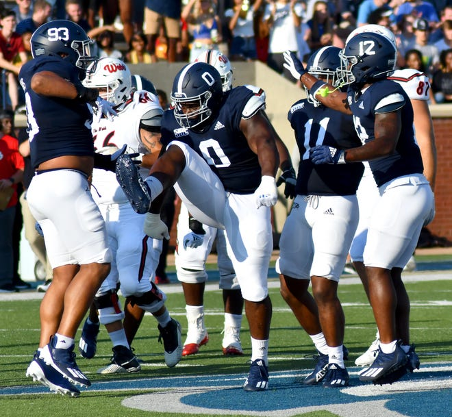 Georgia Southern nose tackle CJ Wright high steps in celebration of his tackle for a loss of Gardner-Webb running back Jalin Graham Sept. 4 in Paulson Stadium. A former Screven County standout, Wright was designated through a new Eagles tradition the No. 0 jersey this football season as a defensive line leader.