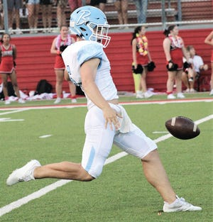 Harrison Clark gets ready to launch the ball for Bartlesville High School during last Friday's season opener.