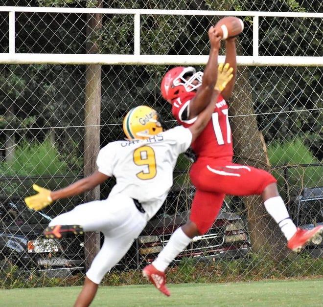Wade Hampton High School's Robert Clark snags a pass from above.