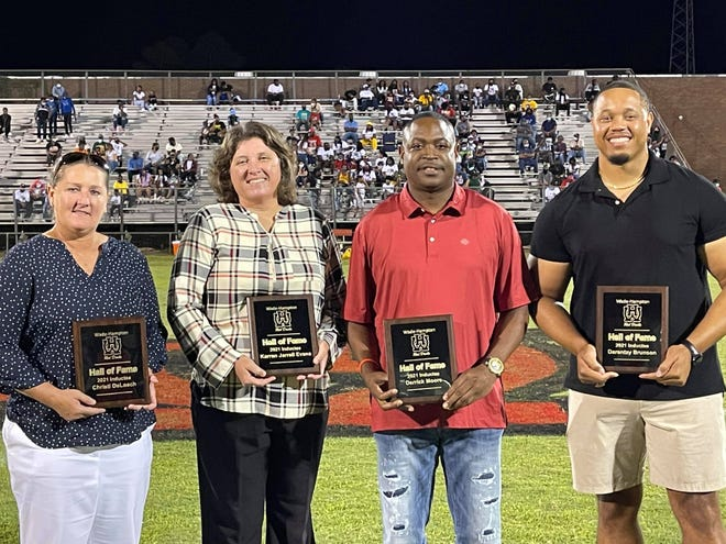At halftime on Friday night, Wade Hampton High School inducted the 2021 Class into its Athletics Hall of Fame. Pictured from left are: Christi DeLoach, Karen Jarrell Evans, Derrick Moore, and Darantzy Brunson.