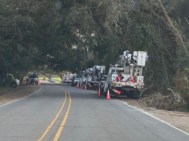 Linemen work together along Hwy. 1 near the Palo Alto bridge over Bayou Lafourche near Donaldsonville.