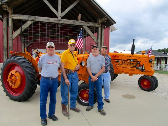 Randy Goddard, left; John DeReu, Chad Jacobs and Jim Gradert are shown with the 1949 and 1952 Minneapolis-Moline tractors that will be on display at this year's Antique Engine & Tractor Association's annual show, Sept. 17-19. John DeReu owns the two tractors in the photo
