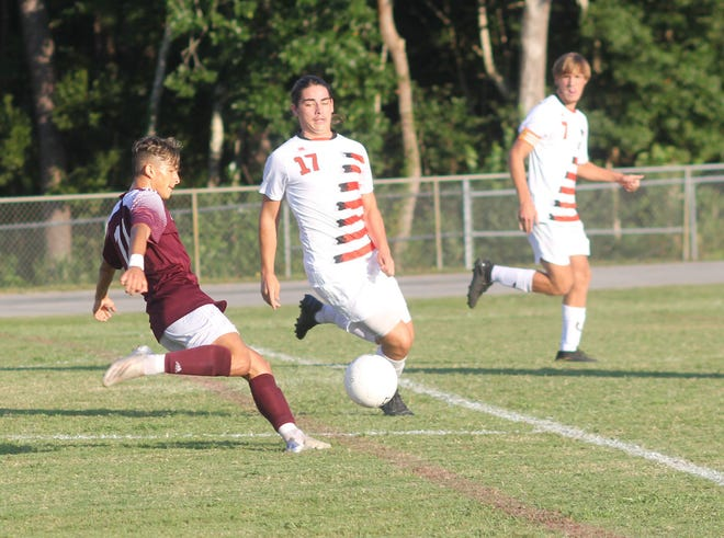 Dixon's Bryan Gussman, left, scored the only goal in the Bulldogs' 1-0 win over Southwest on Sept. 2.