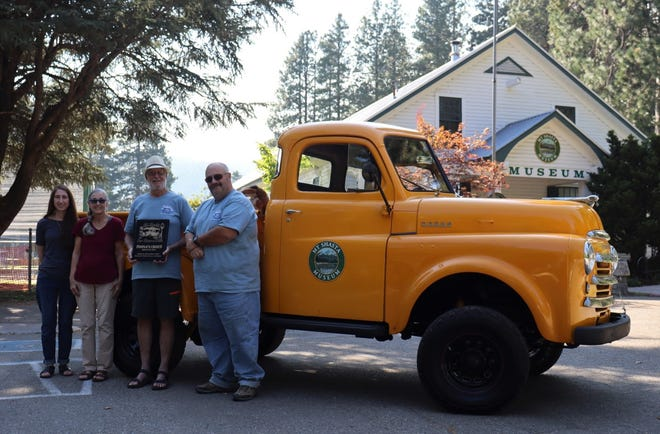 """People's Choic Award this year went to Jim and Linda McChesney for their 1949 Dodge Pick-up named """"Susie,"""" which is also the mascot for the Mt. Shasta Sisson Museum. Pictured are musuem executive director Rosemary Romero; Linda McChesney; Jim McChesney; and Rusty Owens, Member of the Siskiyou Masonic Lodge."""