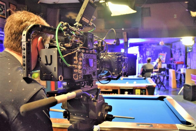 """A cameraman filming a scene from the upcoming movie """"Peter Five Eight."""" Starring Kevin Spacey, the movie is being filmed in many Dunsmuir businesses including Spirits Bar and Lounge and  Dunsmuir Hardware, as well as outdoors on Dunsmuir Avenue."""