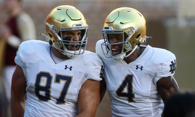 Notre Dame tight end Michael Mayer (87) celebrates his touchdown with teammate wide receiver Kevin Austin Jr. (4) against Florida State in the first quarter of an NCAA college football game Sunday, Sept. 5, 2021, in Tallahassee, Fla.
