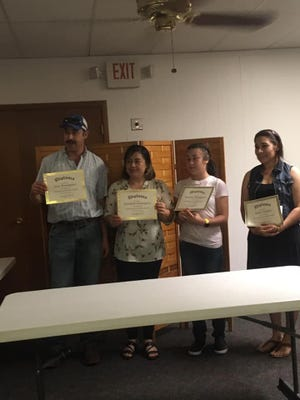 The Stafford branch of CORE Community in Stafford County recently graduated four members from the volunteer program.