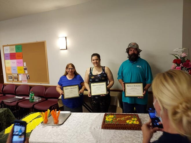 Recent CORE Community graduates in St. John enjoy a special ceremony in their honor.