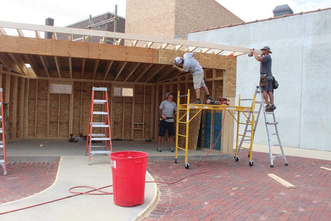 Chase Galle and members of the J.A Knight Construction crew put together the pieces of an enclosed band shell on Thursday at Merchants Park, located at the corner of Fourth Street and Main in Pratt.