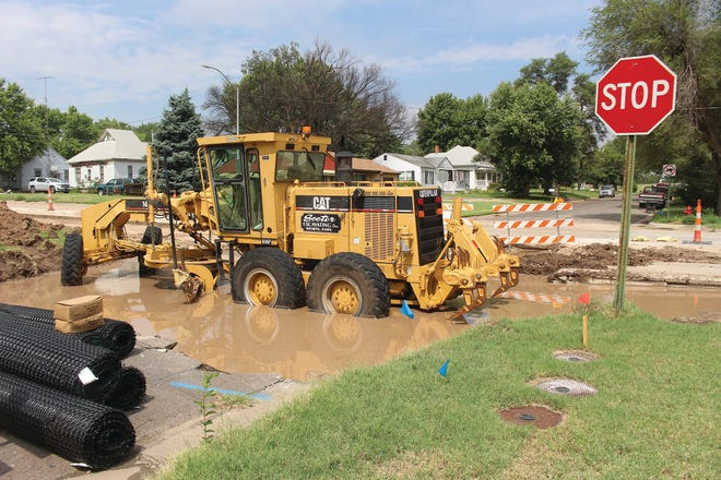 Road work on Pratt's main thorough-fair, First Street, also known as U.S. Highway 54/400 will experience a slight delay due to rain that fell on Friday, creating a gigantic mud hole at the Mound and First street intersection.