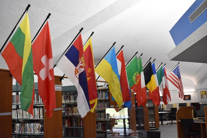 Colorful flags grace the spaces of The Pratt Community College Linda Hunt Memorial Library, representing the different nationalities of students in attendance there this year.